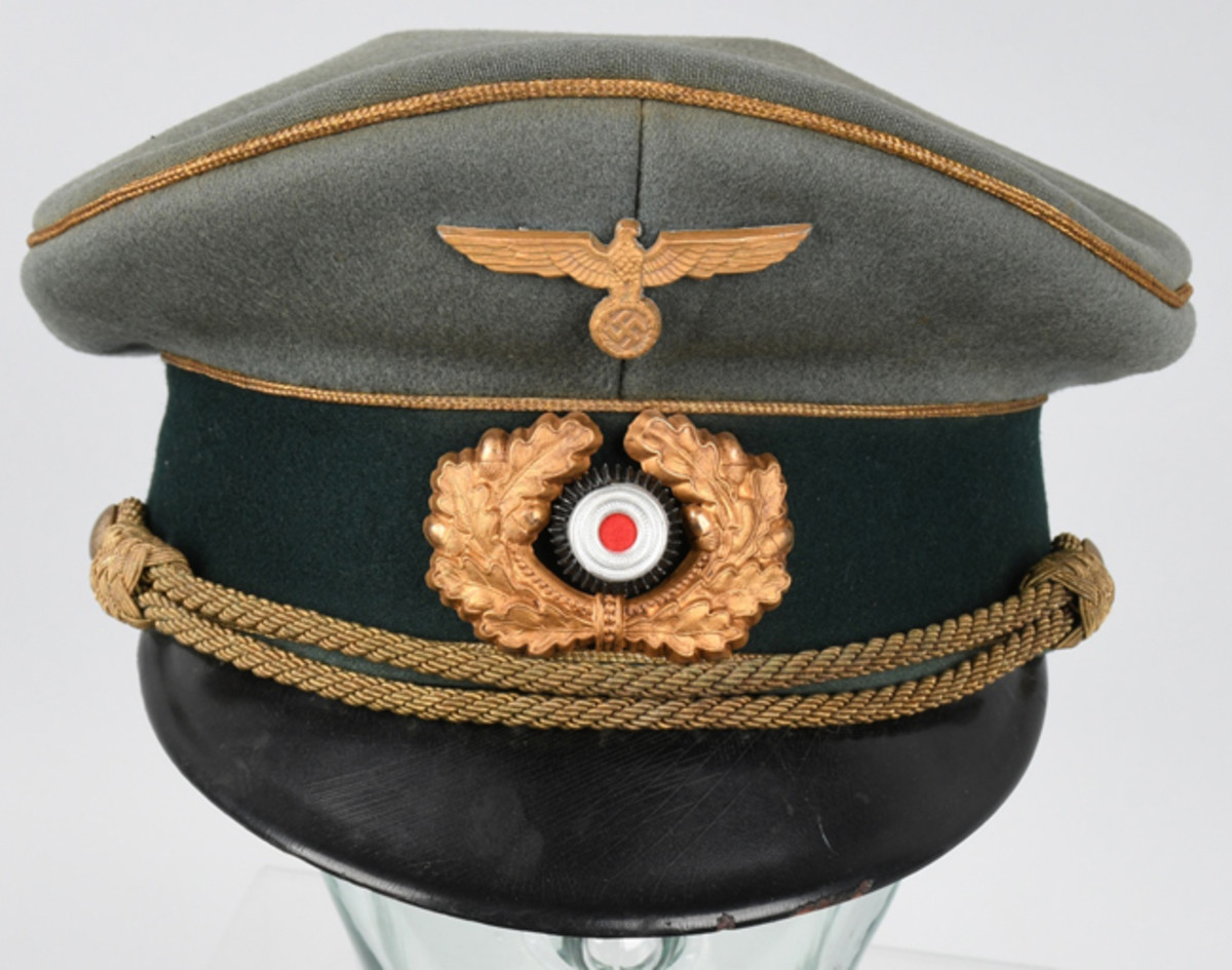 1942-pattern Heer General Officer's visor cap made by Heinrich Kuhner, piped in gold bullion with additional gold-colored decorations. Identified to General Major Josef Prinner.