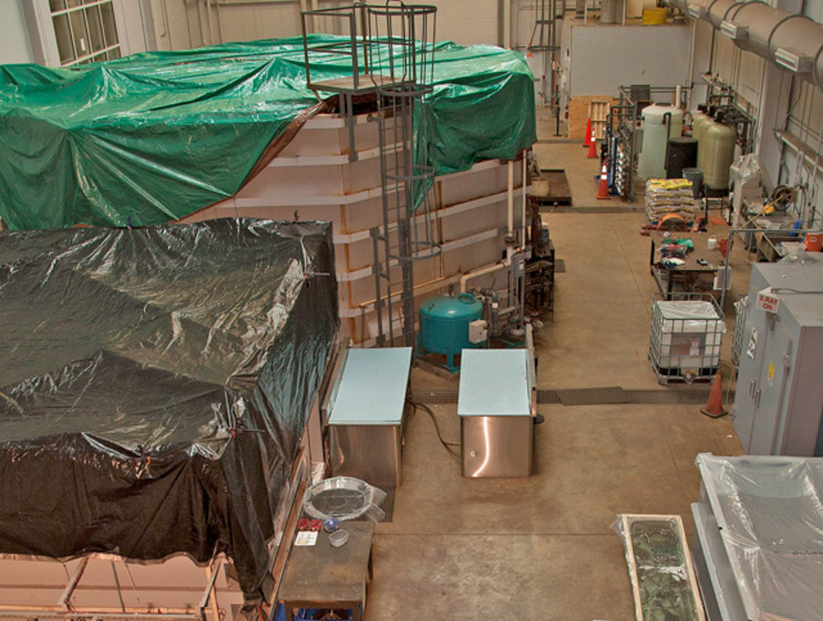 "The USS Monitor Center's ""wet lab,"" inside The Mariners' Museum's Batten Laboratory Conservation Complex, as seen recently after tarps were placed over tanks housing large artifacts from the USS Monitor, including its revolving gun turret and steam engine."