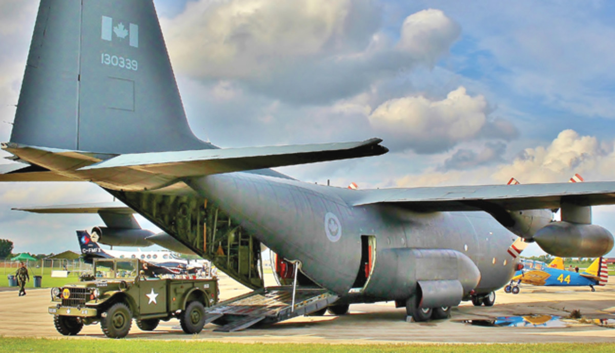 At the Gathering of Warbirds in Waukesha, Wisconsin, in 2016, the Canadian C130 crew was kind enough to let us set up this shot. They even moved the ramps so it looked like we had just unloaded the truck.
