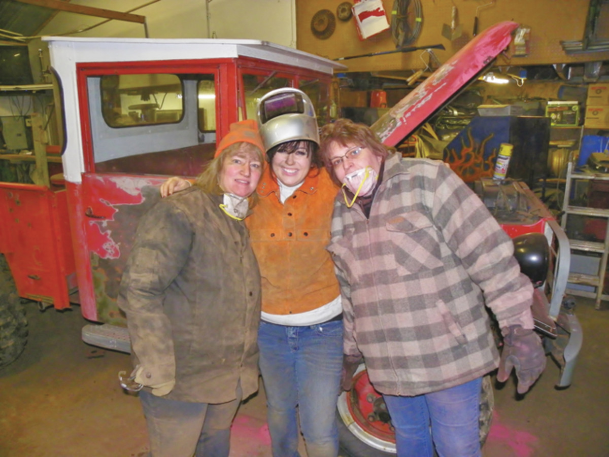 "When I decided to restore the truck and to start removing all those years of paint, my girlfriend and my family jumped right in. Left to right: My sister-in law Linda; girlfriend Yvonne; and my sister, Cindy. Back when I had showed up with the Honda to trade for the truck, Linda had asked, ""Why would you trade a nice, shiny motorcycle for a beat-up, old truck?"" Now that the restoration is done, she gets it."