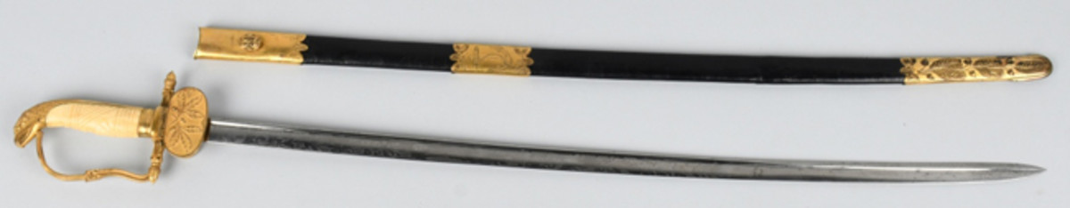 All-original U.S. Navy officer's Model 1841 Eaglehead sword with 28-inch blade, gilt embellishments, and scabbard. Made by N.P. Ames, Cutler.