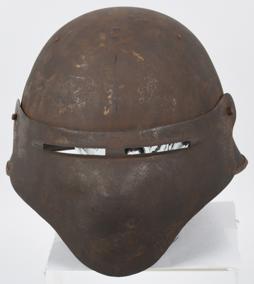 "WWI U.S. Model 8 experimental shield, one of approximately 1,300 created by Ford Motor Company in 1918 as a possible replacement to the ""doughboy"" helmet. One of very few known intact examples."