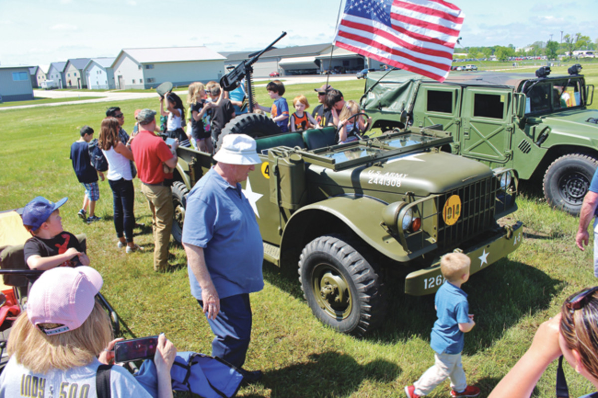 Maggie always draws a crowd. Kids love having their pictures taken standing behind the gun. We provide the props and let the kids get behind the wheel . They love the hands-on experience with the truck and with the history.