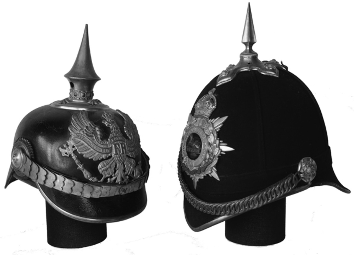 A side-by-side comparison of a Prussian Model 1891 officer's helmet and a British 1878 Pattern Home Service Helmet to Gloucestershire Regiment. The helmets have only a passing resemblance but the materials differ greatly, as does the overall shape. (Collection of the Author)