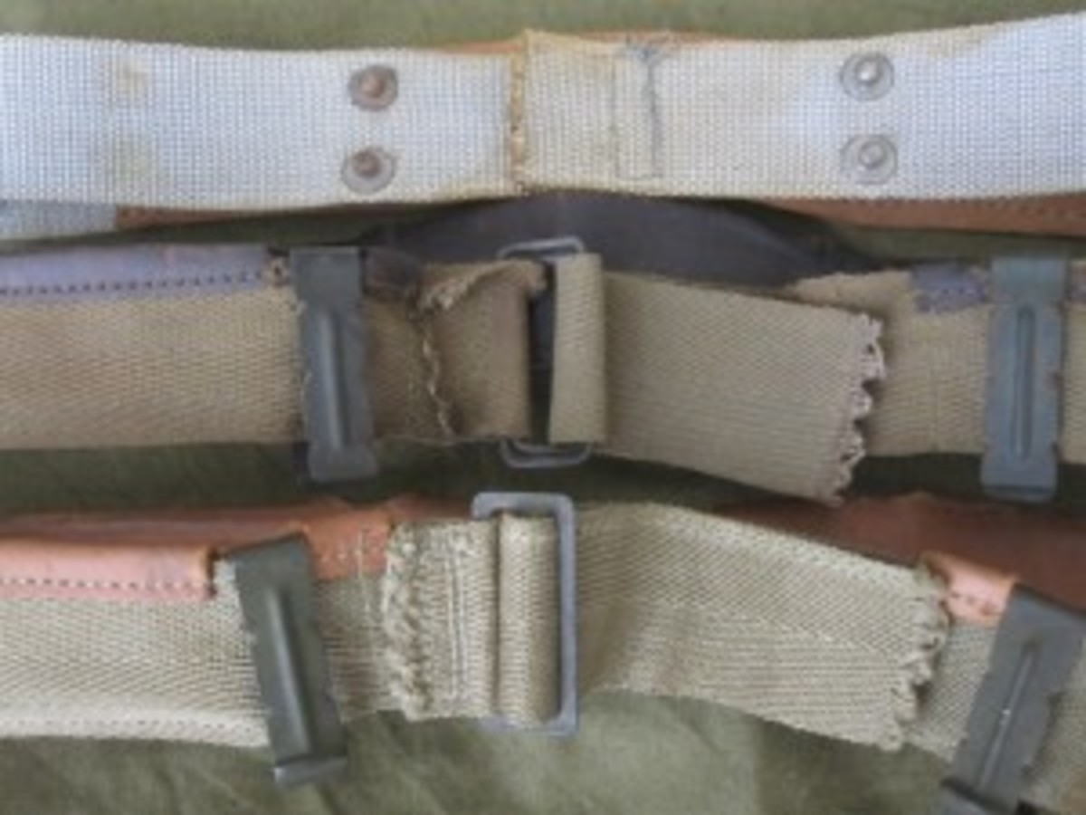 The headband underwent two major changes during WWII after the initial adoption of the M1 helmet with the rayon suspension. From top to bottom: Non-adjustable rayon partially lined, button-in headband; First pattern cotton clip-in headband fully lined with leather or substitute and adjusted by two wire rings; and Second pattern cotton headband with final buckle adjustment.