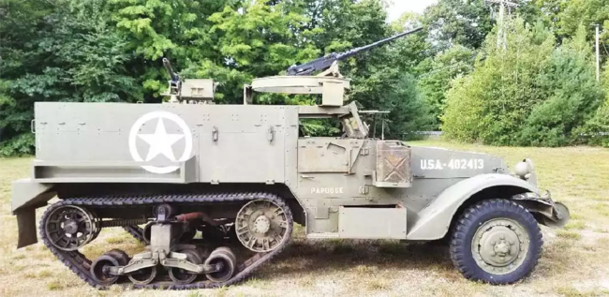 World War II U.S. Military M3 half-track vehicle in good running order with dummy display .50 caliber machine gun on ring mount. Est. $40,000-$60,000