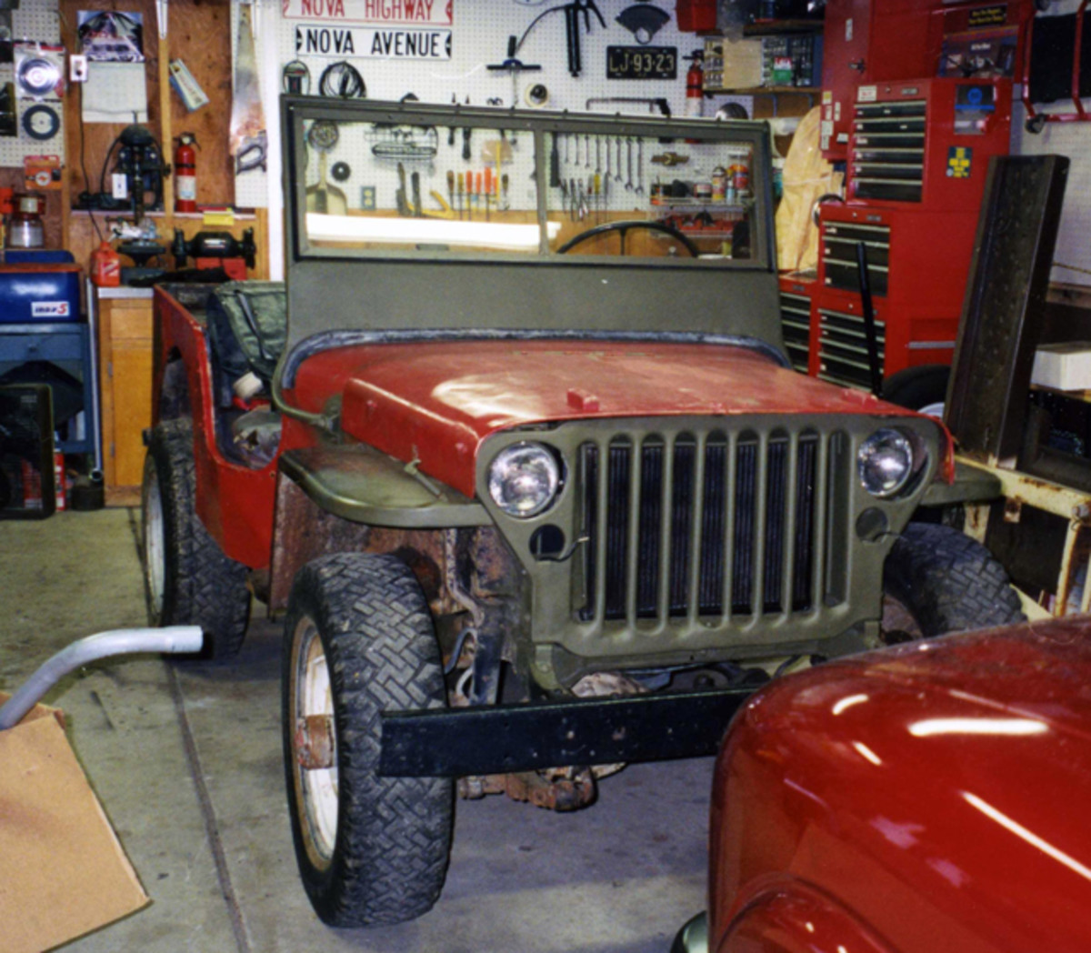 My first historic military vehicle, a 1942 GPW purchased off eBay for a song. It came with boxes of new parts, paint, and an extra CJ-2 driveline as a bonus—all good stuff for bartering.