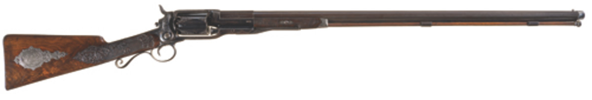 Lot 1277: This previously undiscovered deluxe, panel scene engraved Colt Model 1855 revolving shotgun chieved $138,000.