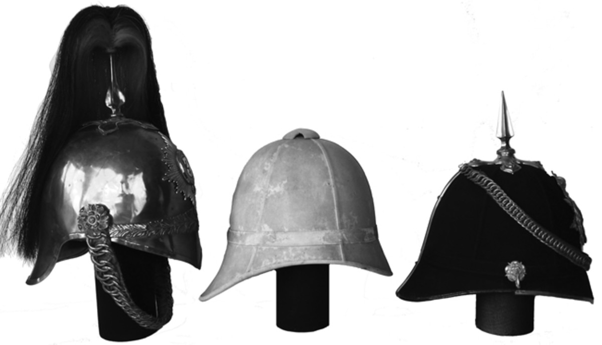 A comparison of the British 1871 Pattern Cavalry Helmet (left) with an early Foreign Service Helmet (center) and an early Home Service Helmet (right) highlighting how these helmets had a similar profile. Note that the British spike is narrow and closely resembles the plume holder of the cavalry helmet. (Collection of the Author)