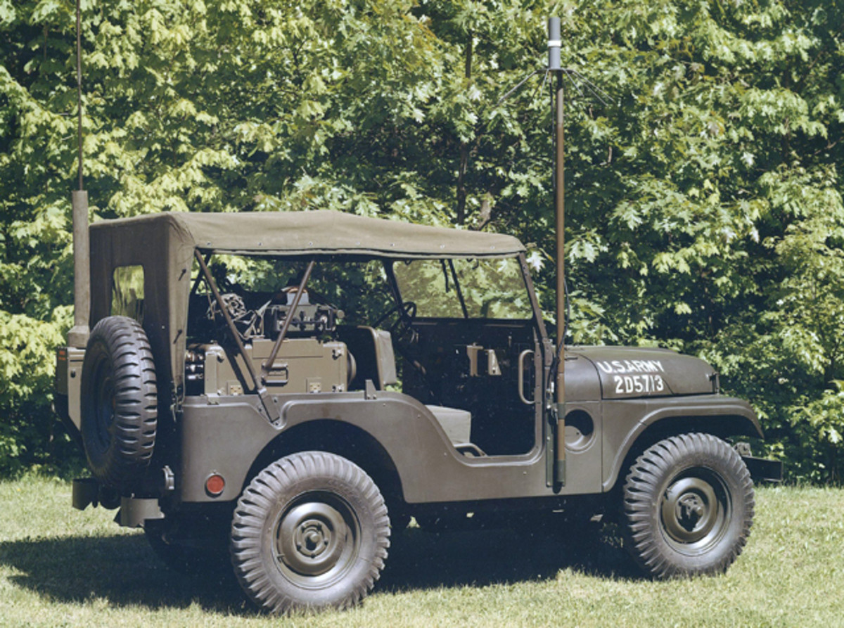 Another photo of the same M38A1 with MRC-108 electronics, this one with the canvas top attached and the vehicular UHF AM antenna erected.