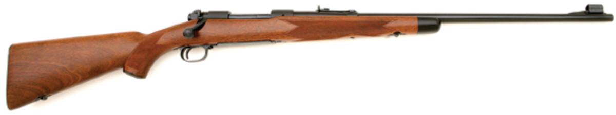 Winchester pre '64 Model 70 Supergrade Rifle. SOLD: $8,625.