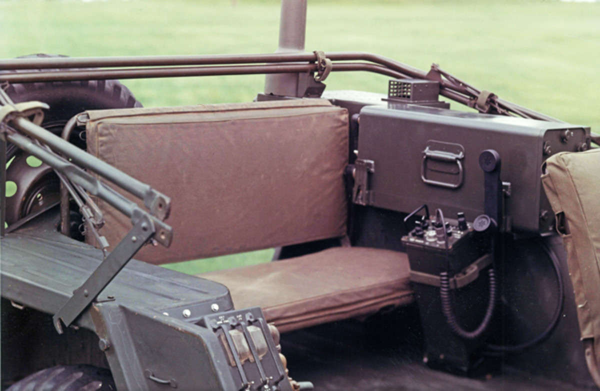 Here is a 718U-2 (AN/VRC-80) in a different M151 jeep. The 718U-2 is also a 400W HF radio, again built using URG-2 slices. The -2 version uses a separate 671U-1 receiver/exciter, which is shown next to the radio case and in front of the jeep's rear seat. Note that, with the separate 671U-1 receiver/exciter rather than an internal 671U-4A receiver/exciter, the 718U-2 main radio case is narrower than case on the 718U-2A pictured above. All the 718U-2 variants use the same power amplifier module & power supply module & antenna coupler case.