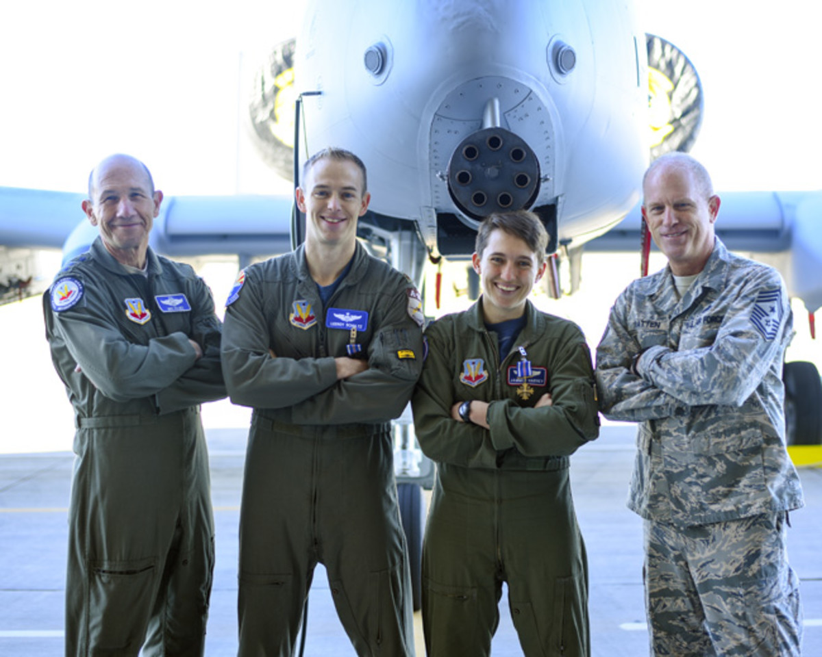 U.S. Air Force Gen. Mike Holmes, Air Combat Command commander, Maj. Tyler Schultz and Capt. Samantha Harvey, 354th Fighter Squadron A-10C Thunderbolt II fighter pilots, and Chief Master Sgt. Frank Batten III, Air Combat Command command chief pose for a picture at Davis-Monthan Air Force Base, Ariz., March 2, 2018. Holmes presented Schultz and Harvey with the Distinguished Flying Cross for conducting an emergency aerial flight in support of U.S. Army forces near Shaddadi, Syria, on May 2, 2017 (U.S. Air Force photo by Giovanni Sims)
