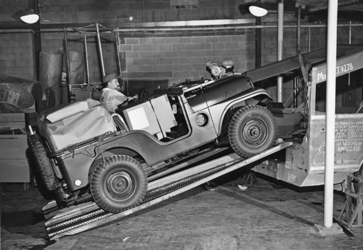 Still at the Alpha facility, here's a teamster type driving the finished product up onto a car transporter. Note that the TRC-75 install really flattens out the rear springs in the M38A1.