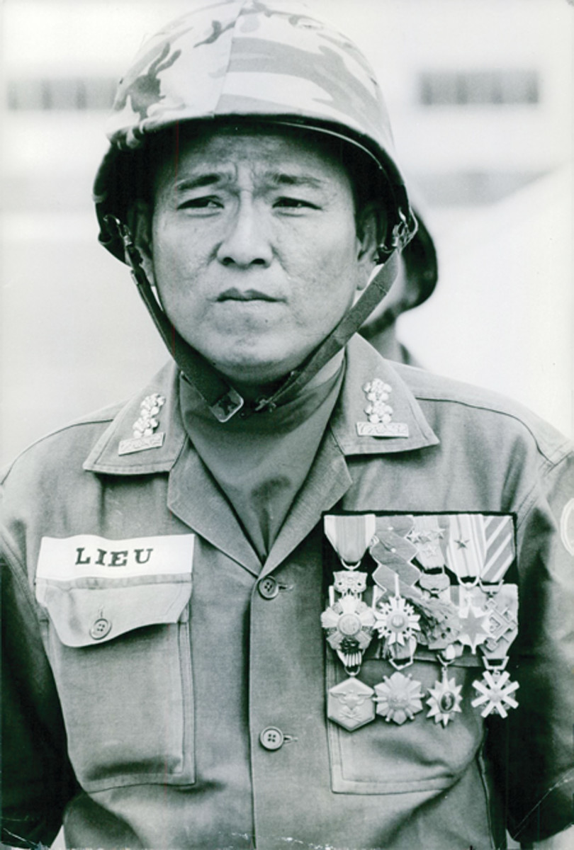 "Undated press photo just has ""Long Binh"" written on it. Long Binh functioned as a U.S. Army base, logistics center, and major command headquarters for United States Army Vietnam (USARV) during the Vietnam War."