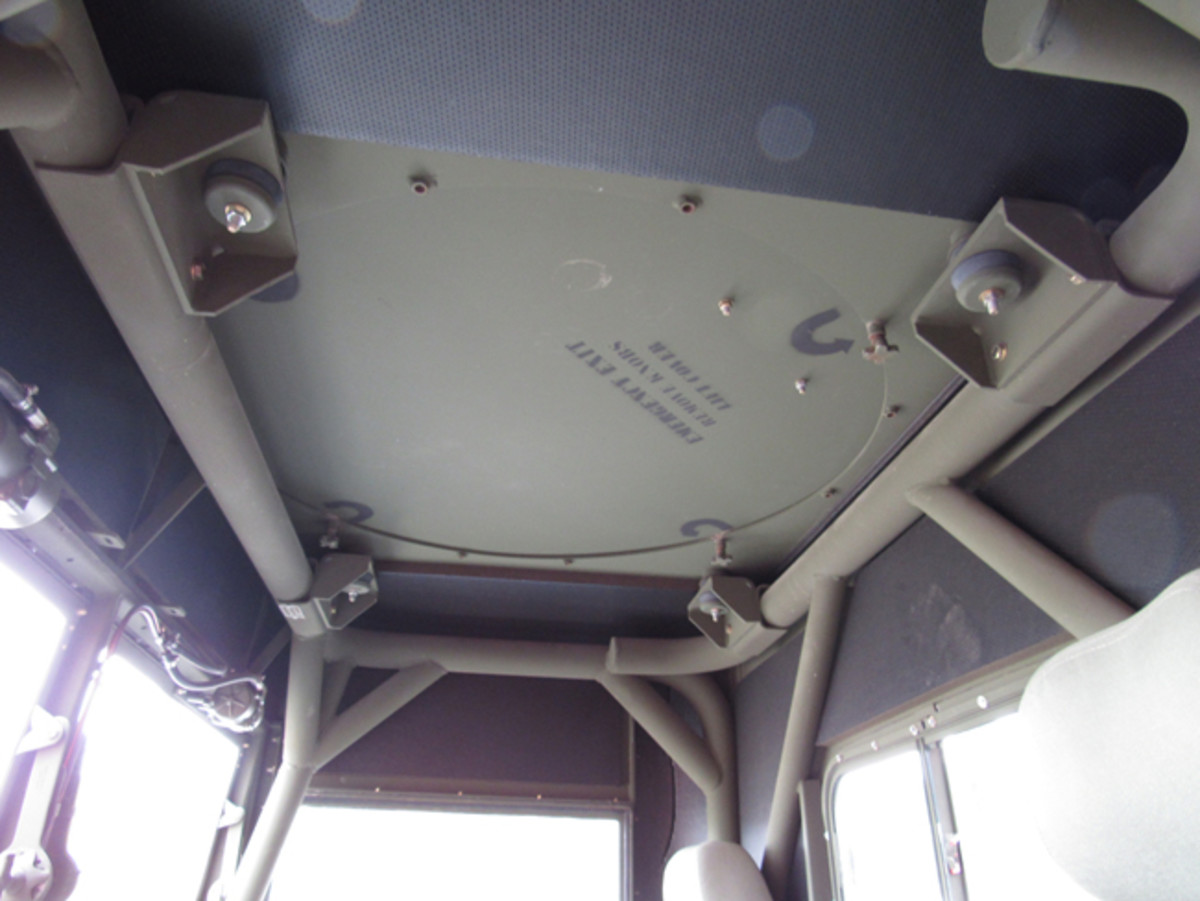 Looking up from the driver's position, the roll cage and escape hatch are visible.