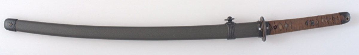 This style of Japanese army sword and mounting was introduced about 1944. The mounting diverges from that of its predecessor in that the hilt wrapping is different, often there are two pins or a screw and a pin to secure the sword in the hilt, and the scabbard (not shown) is lacquered a matte shade of khaki or brown.