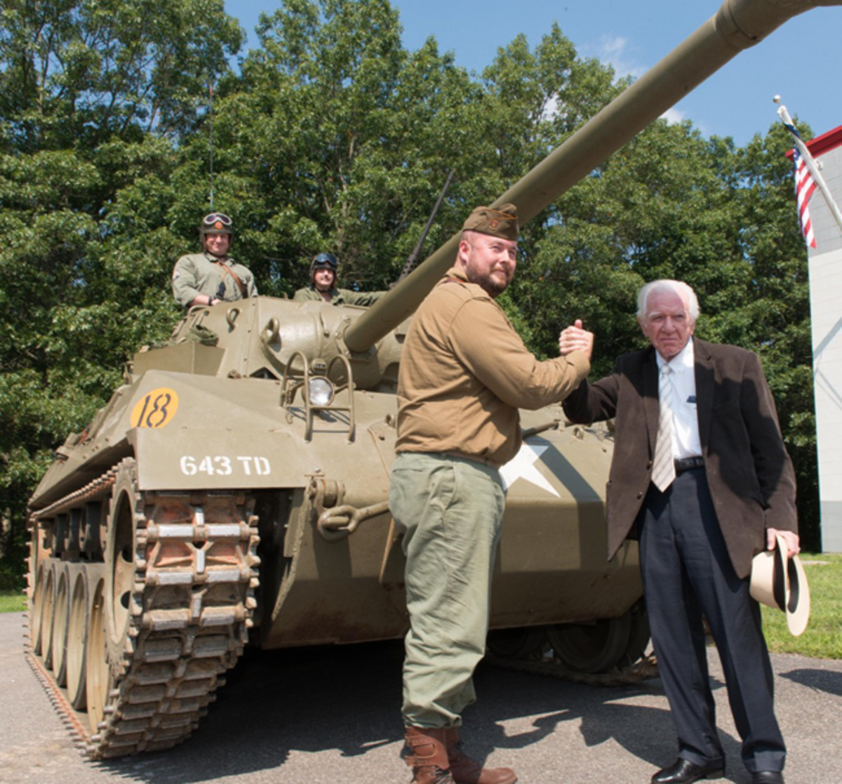 Lawrence Kadish, founder of the Museum of American Armor welcomes (right) Al Barto of the U.S. Military Museum, Danbury, Connecticut as the New England museum donates its exhibits and armor assets to the New York institution in an unprecedented gift that allows their legacy to live on in a new home.