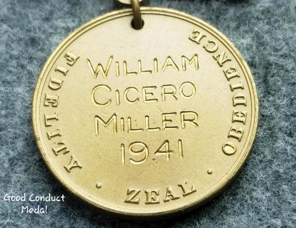 Reverse of the USN Good Conduct Medal engraved with Miller's name and the date of award, 1941.