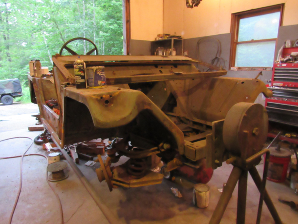 he donor M151A2 being converted to right hand drive on a Jeep-rotisserie.