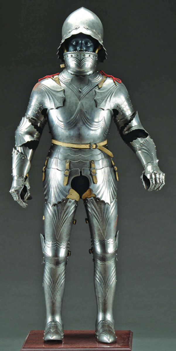 "A fine full ""Gothic"" plate suit of armor for a youth. Excellent form and in the style of a 15th century suit of armor but circa 1850. In outstanding condition, a great rarity estimated at $50,000-80,000."