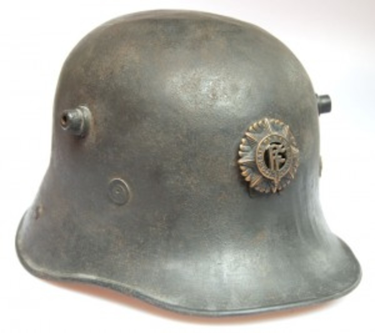 "The Model 1928 Irish steel helmet made by Vickers was based on the German Model 1916. Introduced in late 1928, these ""German"" helmets remained in use until 1940. This example is fitted with an original Irish-made badge. (Collection of the Author)"