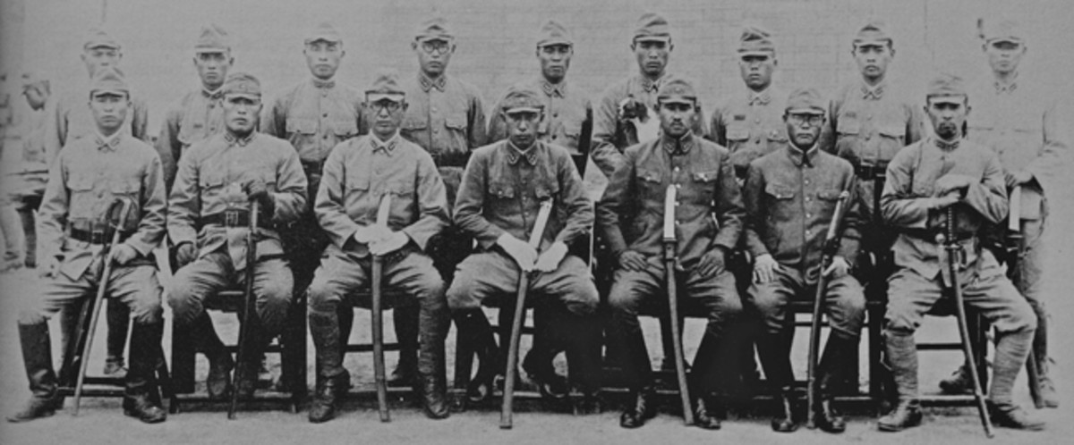 This photograph was taken in China in 1941. The Japanese soldiers in the front row all have swords in an array of different types and styles.