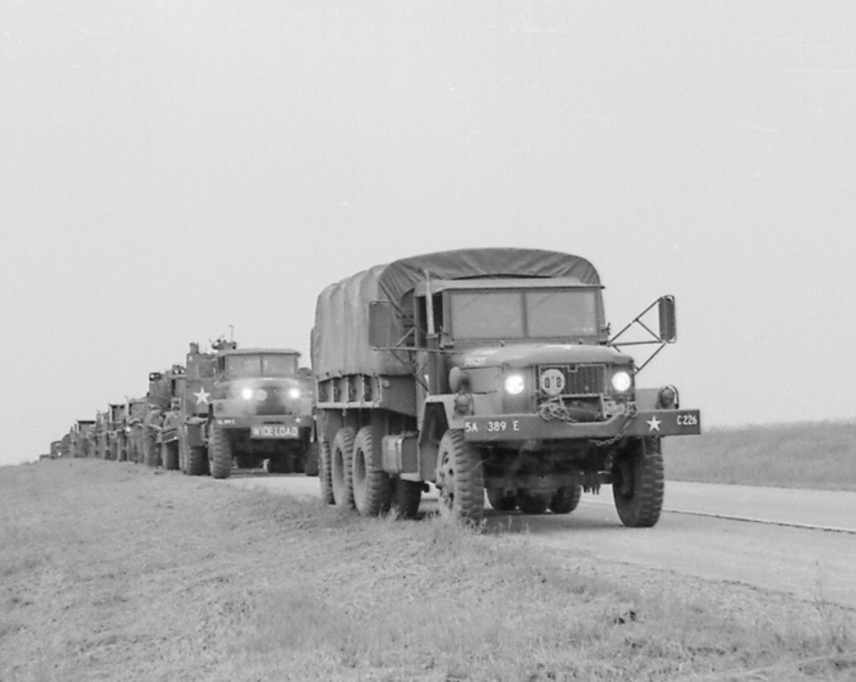 "I was probably about 12 or 13 years old when I photographed this convoy outside of Caledonia, Minnesota around 1974 -- to GIs who took time to chat with me referred to their truck as a ""Deuce."""