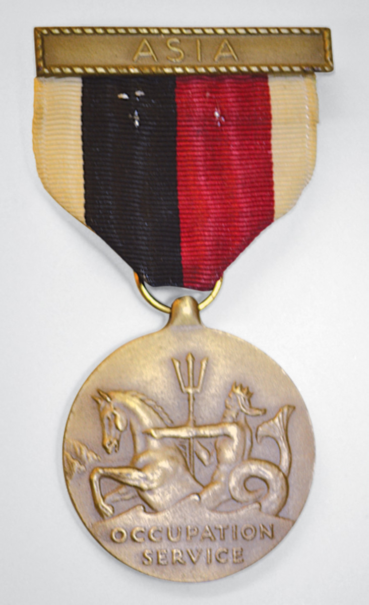 The Navy and Marine version of the Japanese Occupation medal has a nautical theme. The reverse features one of two possible configurations that depict an Eagle sitting on a horizontal anchor.