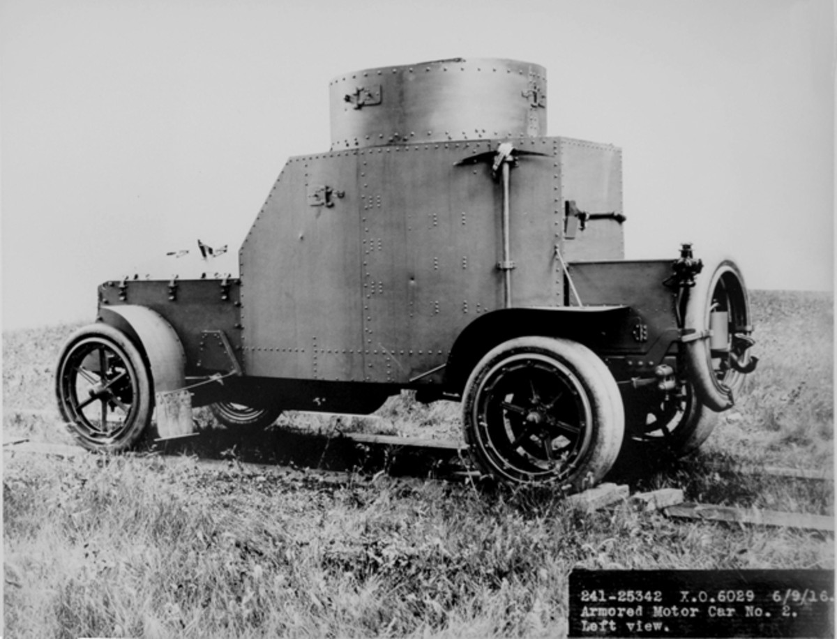 The 36-horsepower four-cylinder engine probably had all it could handle to propel the 9,000-lb vehicle. After testing was completed at Fort Sill, Armored Car No. 2 was refitted with heavier, dual six-spoke rims and pneumatic tires. This June 1916 photo of Armored Car No. 2 shows the dual tires on the rear axle, and a spare tire mounted on the rear of the vehicle, encircling a towing pintle hook.