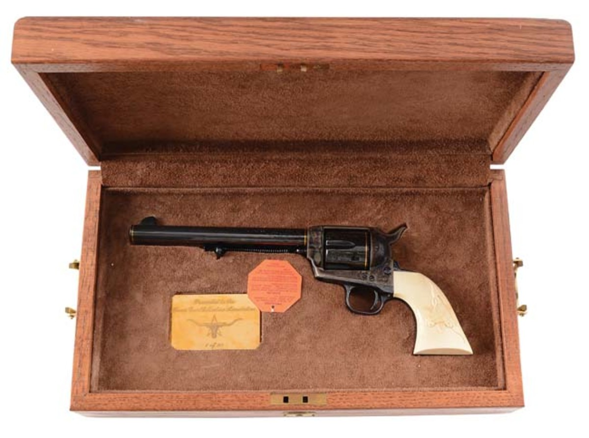 Cased Texas Gun Collectors Association factory-engraved and gold-banded Colt third-generation single-action Army Revolver with relief-carved steer-head grip, manufactured in 1987. Photo - Morphy Auctions