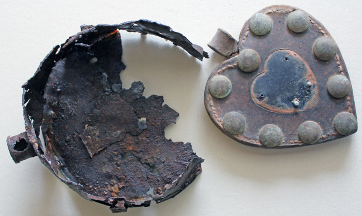 Remains of a Confederate canteen found at the Daniel Lady Farm on the Gettysburg battlefield and a oversize bridle martingale that was part of a collection of Gettysburg relics sold by The Horse Soldier several years ago. The canteen relic is valued at about $200 and the martingale sold for $60. (Author's Collection).