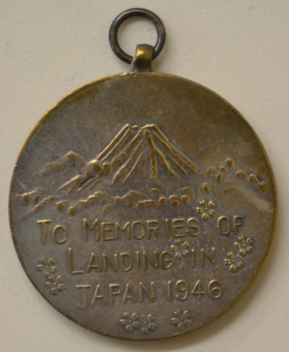 The Mt. Fuji design continued on many of the reverses of various souvenir medals, regardless of shape or design.