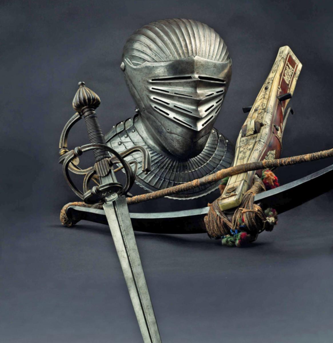 Saxon heavy sword, 1600, Maximilian style helmet + A German crossbow, 1600. SP: 14000 + 30000 + 12000 Euros