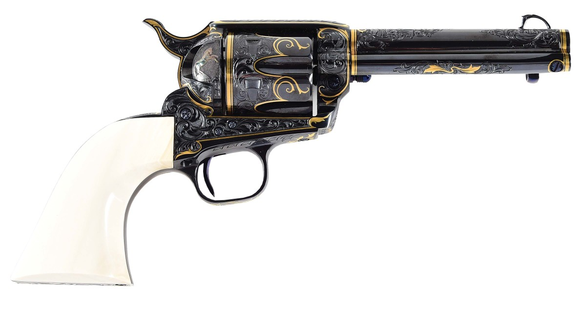 Tim George engraved and gold-inlaid Colt single-action Army Revolver with relief-carved steer-head grip. Photo - Morphy Auctions