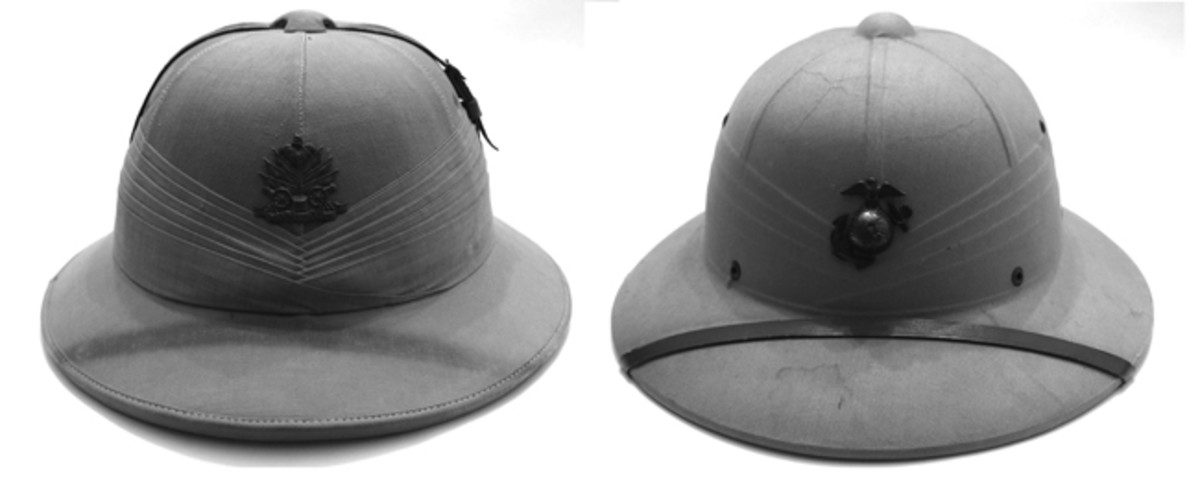 Photos that show side-by-side comparison of the Standard Pattern and the USMC pressed fiber helmet. Note that the helmets are similar in profile and that the pressed fiber version attempted to simulate the puggaree and helmet panels/seams and even ventilator cap. The Garde d'Haiti helmet may have been used by an officer as it featured the extra leather band (part of the chinstrap) which went over the helmet's top. (Collection of the author).