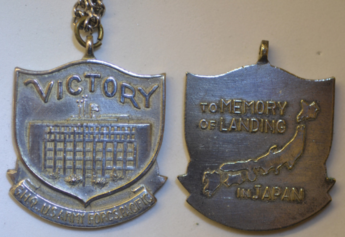 Other shapes of souvenir medals depicting the General Headquarters of the U.S. Army Forces Pacific included a shield.