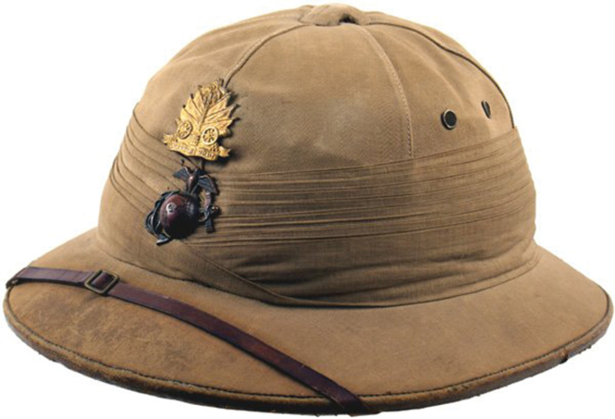 British-made helmet to the Garde d'Haiti. This helmet features the cap badge of the Garde d'Haiti along with the USMC's Eagle/Globe/Anchor insignia (Private collection).