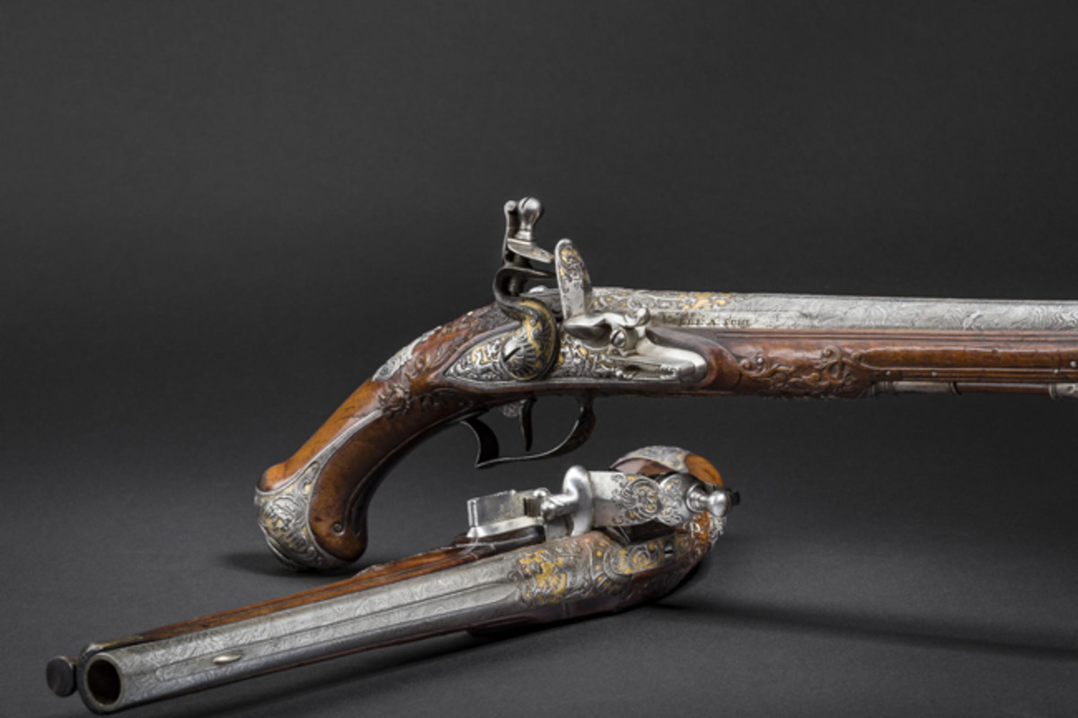Pair of silver-mounted, chiselled and gilt flintlock pistols, produced circa 1745.