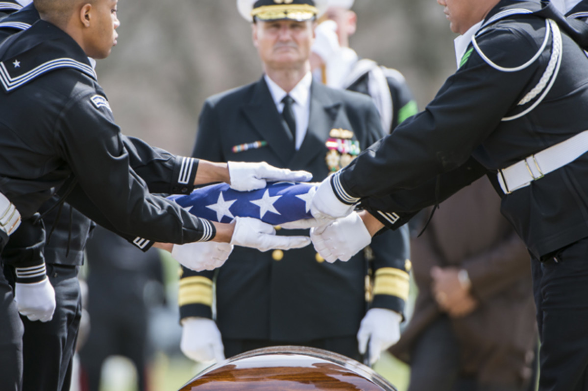 Sailors from The U.S. Navy Ceremonial Guard fold the American flag during the full honors funeral of U.S. Navy Capt. Thomas J. Hudner in Section 54 of Arlington National Cemetery, Arlington, Virginia, Apr. 4, 2018.