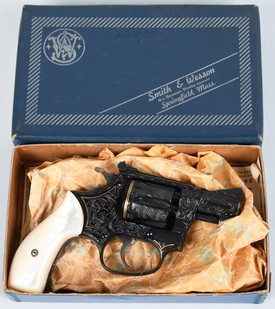 Smith & Wesson 6-shot double-action revolver with pearl grips and engraving by Billy Bates, $4,400