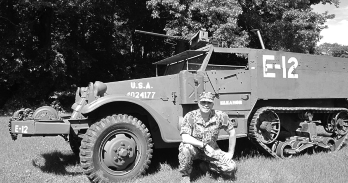 """Cullen's son - Jim Cullen II - grew up hearing stories of his father's half-track, nicknamed, """"Eleanor"""" and what the men in his company were like. When the younger Cullen was sent to Afghanistan, he nicknamed his HMMWV, """"Eleanor,"""" in honor of his Dad's half-track. Here, he is posed with a recreation of the WWII Eleanor half-track. Photo courtesy of James Cullen II"""