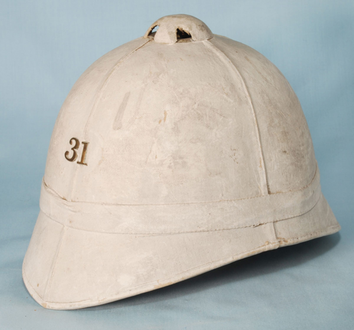 Similar in design to the U.S. Army sun helmets the National Guard helmets featured a more pointed front visor. These helmets are often misrepresented as U.S. Army or even USMC helmets (Collection of the author).