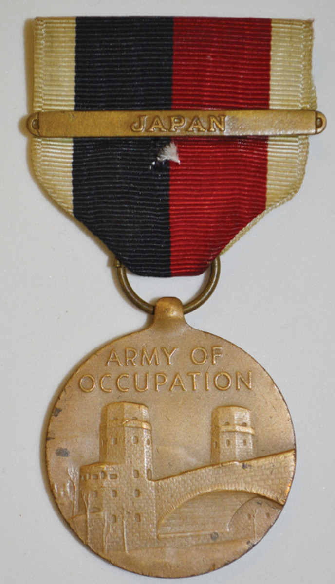 The Army and Air Force Occupation Medal shows a Japan bar for forces in the Japan Occupation. The reverse features Japanese boats with Mt. Fuji in background.