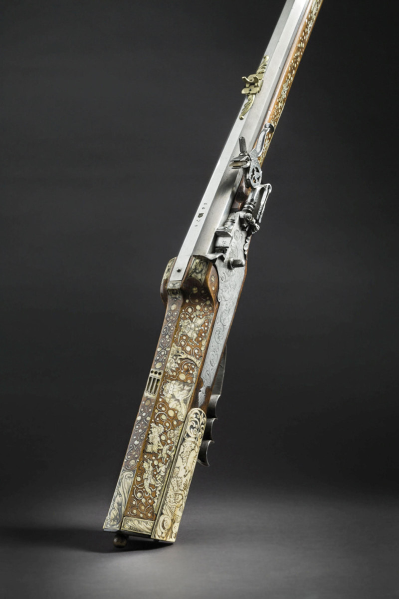 A Bohemian lavishly bone-inlaid wheellock hunting rifle, dated 1678.