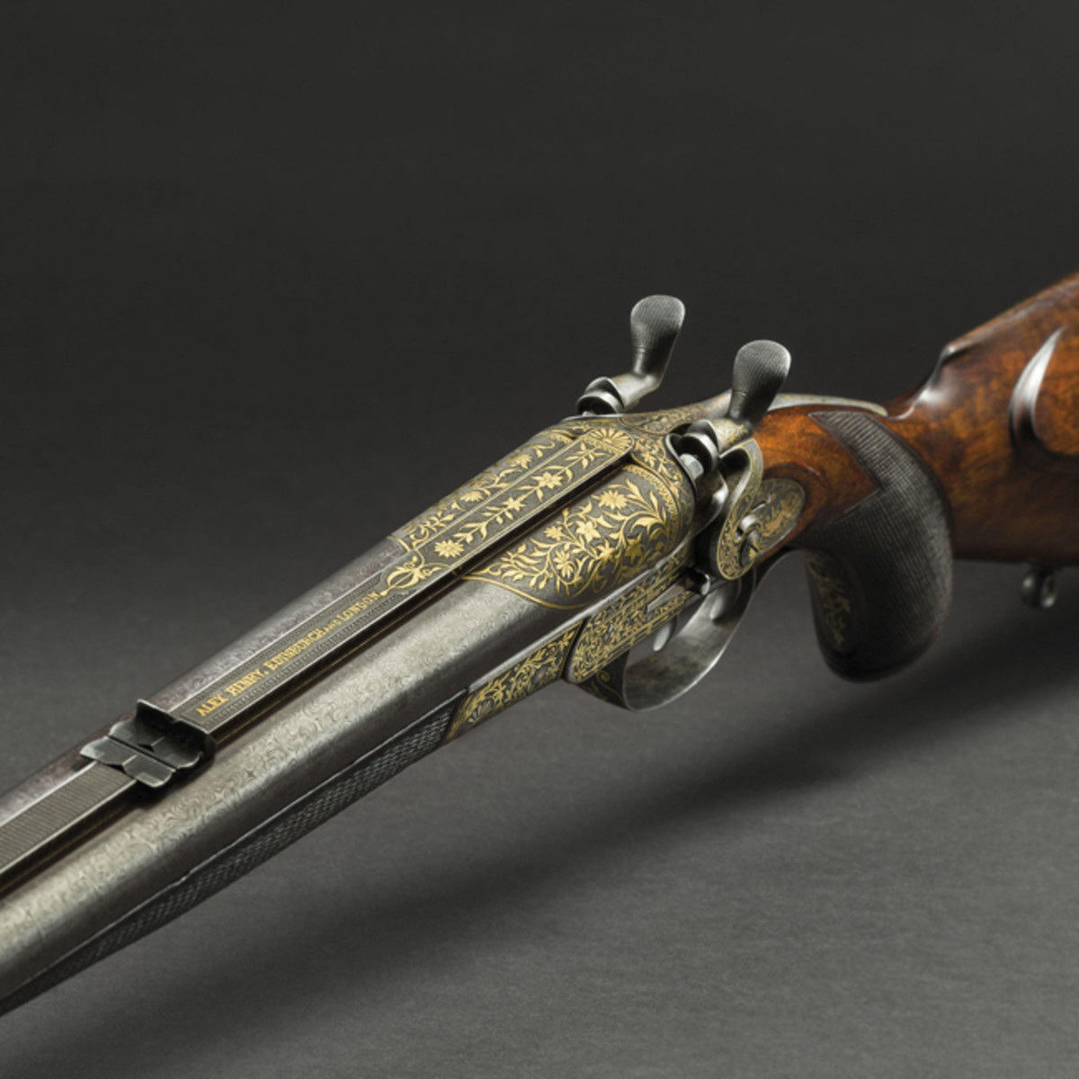 Gold-inlaid damascus top-hammer double rifle, Alexander Henry.