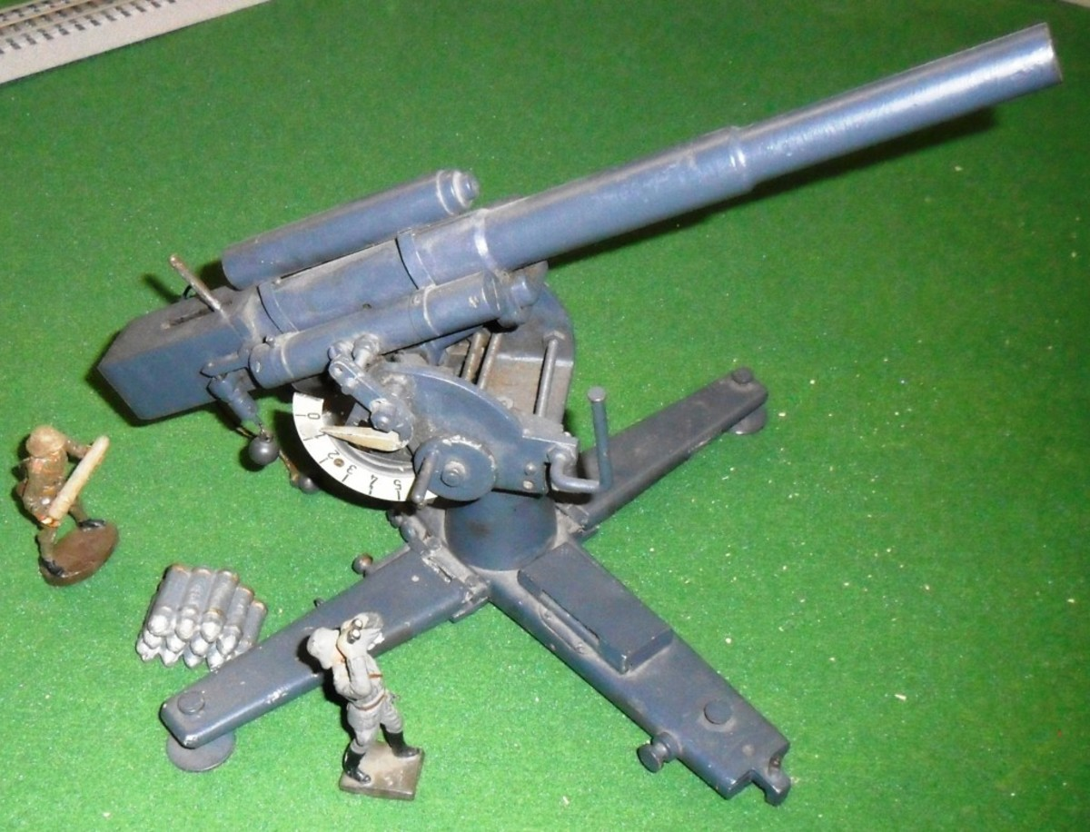 Favorite find: A very accurate model of a WWII German 88mm cannon. It is highly detailed and appears to be of the period. The cannon swivels, raises, and lowers, and it has a working breech. Andrew doesn't know if it's a salesman's model, a toy, or a factory piece, but it certainly looks great with his other tinplate German toys!