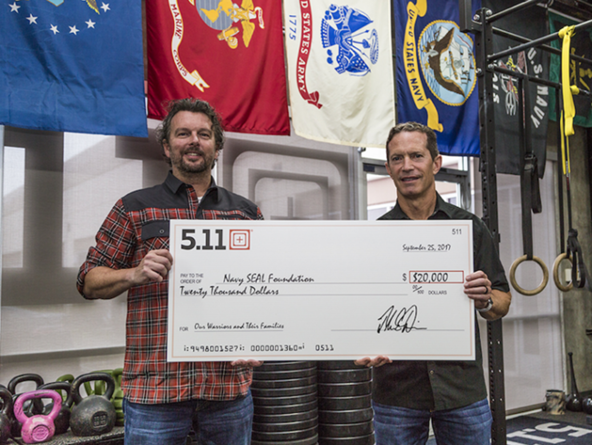 Driessen and 5.11 CEO, Tom Davin, holding the $20,000 check for Navy SEAL Foundation