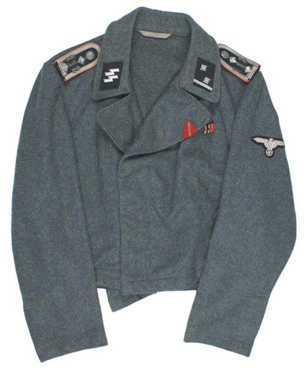 "German World War II ""wrapper"" (waist-length) jacket with machine-sewn W-SS sleeve eagle ($7,000)."