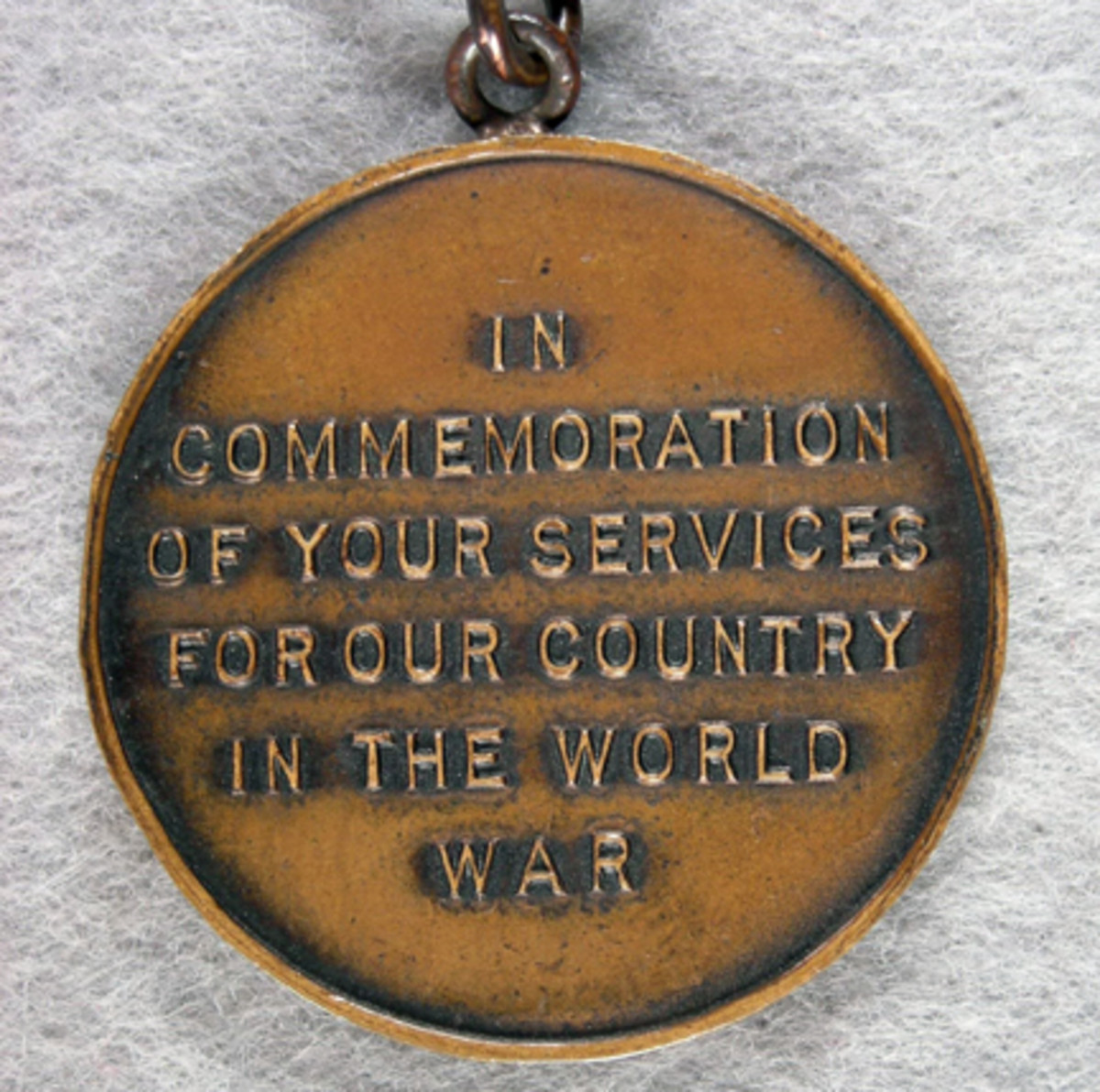"""The inscription of the fob's reverse indicates it was presented by the Knights of Columbus """"In commemoration of your service for our country in the world war."""""""